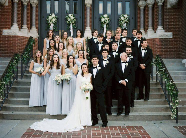 You might not ever guess why this wedding party looks so shocked wedding party reacts photo leslie holilingsworth junglespirit Image collections