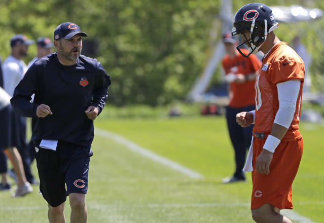 Chicago Bears offensive coordinator Mark Helfrich, left, talks to quarterback Mitchell Trubisky during practice at the NFL football team's training camp in Lake Forest, Ill., Wednesday, May 23, 2018. (AP Photo/Nam Y. Huh)