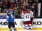 Russian players celebrate after Russea defeated Finland 5-2 in the gold medal match at the Ice Hockey World Championship in Minsk, Belarus, Sunday, May 25, 2014. At left is Finland defender Atte Ohtamaa (5). (AP Photo/Darko Bandic)