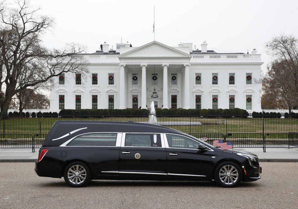 The hearse carrying the flag-draped casket of former President George H.W. Bush passes by the White House from the Capitol, heading to a State Funeral at the National Cathedral, Wednesday, Dec. 5, 2018, in Washington. (Photo: Jacquelyn Martin/AP).