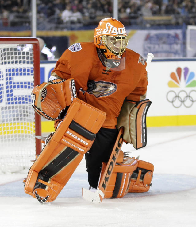 Anaheim Ducks goalie Jonas Hiller, of Switzerland, stops a shot during the second period of an NHL outdoor hockey game against the Los Angeles Kings at Dodger Stadium in Los Angeles, Saturday, Jan. 25, 2014. (AP Photo/Chris Carlson)