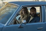 "Rachel Brosnahan, left, and Arinze Kene appear in a scene from the film ""I'm Your Woman."" (Wilson Webb/Amazon Studios via AP)"