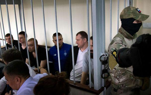 PHOTO: Ukrainian sailors sit in a cage in a courtroom in Moscow, Russia, Wednesday, July 17, 2019. (Alexander Zemlianichenko/AP Photo)