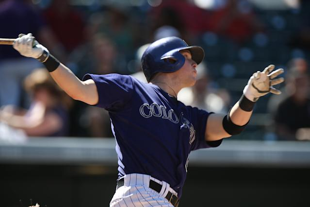 Colorado Rockies' Corey Dickerson watches his solo home run against the San Francisco Giants in the fifth inning of the Rockies' 9-2 victory in a baseball game in Denver on Wednesday, Sept. 3, 2014. (AP Photo/David Zalubowski)