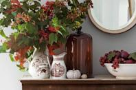 "<p>Let the chilly weather outside be your inspiration for choosing warm finds at the local antiques shop storefront or online store. The homeowner of <a href=""https://www.countryliving.com/home-design/decorating-ideas/g1248/family-friendly-home-decor/"" rel=""nofollow noopener"" target=""_blank"" data-ylk=""slk:this cozy, country home"" class=""link rapid-noclick-resp"">this cozy, country home</a> chose to display foliage in transferware atop a 19th-century mahogany dresser.</p>"