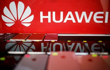 FILE PHOTO: The logo of Huawei is pictured at a mobile phone shop in Singapore, May 21, 2019. REUTERS/Edgar Su