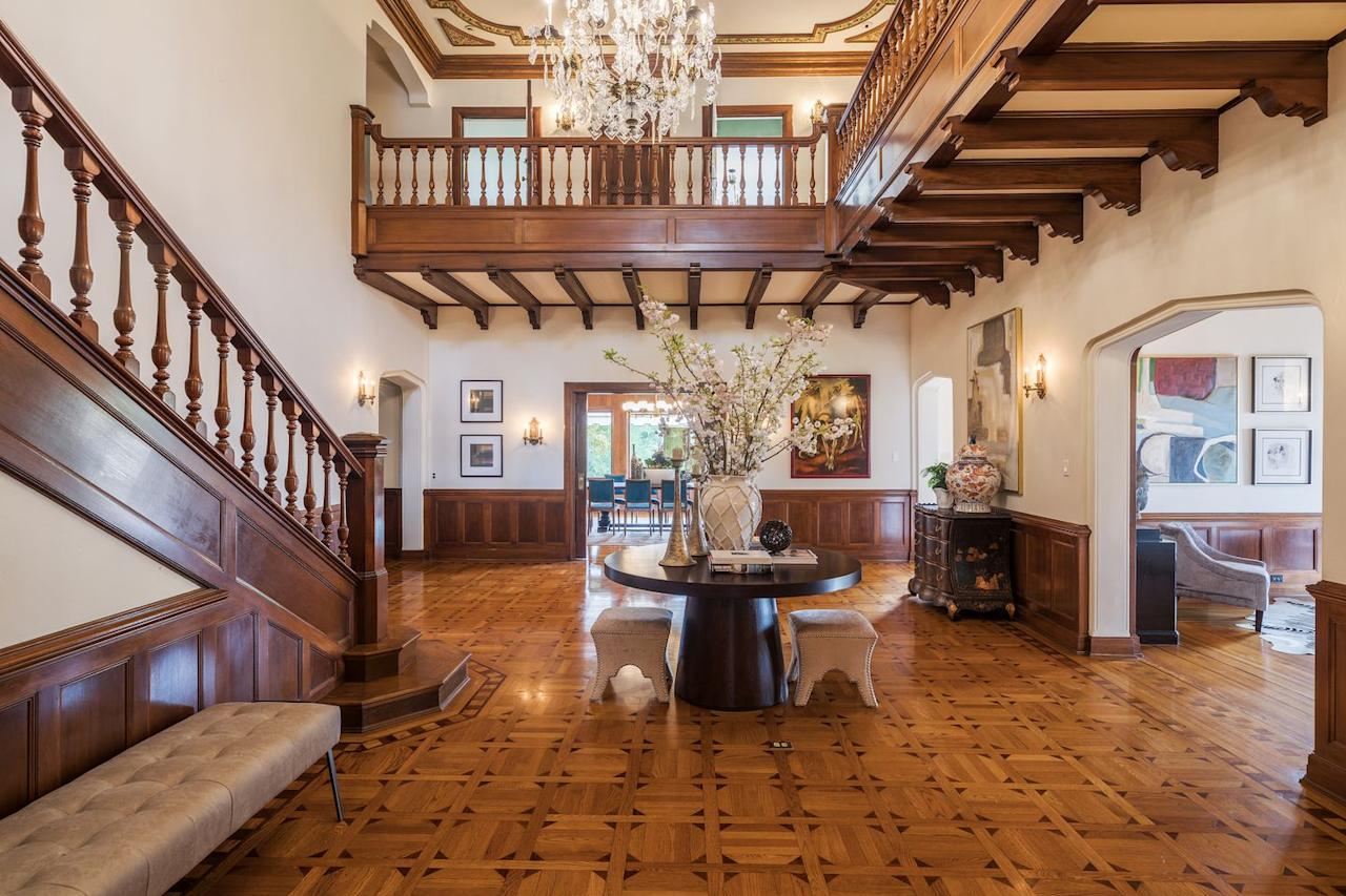 <p>The opulent double-height entrance gallery exudes Old World craftsmanship.</p>