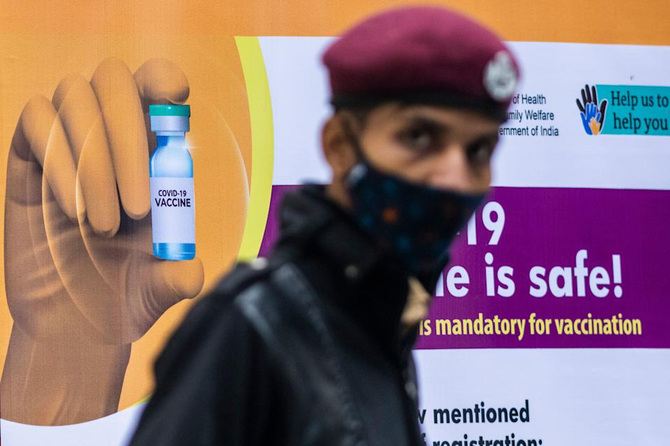 A security guard keeps watch at a Covid-19 coronavirus vaccine centre New Delhi on January 16, 2021. (Photo by Jewel SAMAD / AFP) (Photo by JEWEL SAMAD/AFP via Getty Images)
