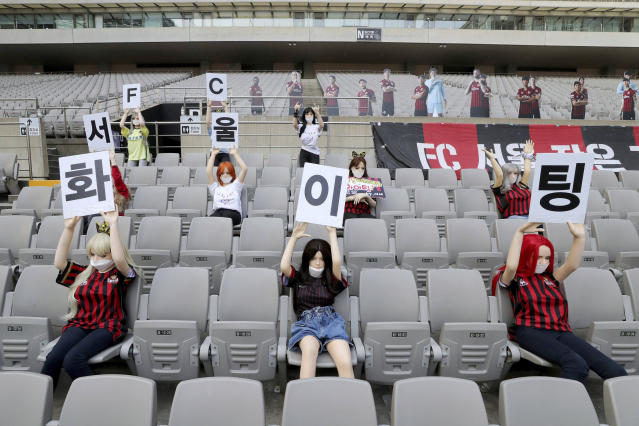 "In this May 17, 2020 photo, Cheering mannequins are installed at the empty spectators' seats before the start of soccer match between FC Seoul and Gwangju FC at the Seoul World Cup Stadium in Seoul, South Korea. A South Korean professional soccer club has apologized after being accused of putting sex dolls in empty stands during a match Sunday in Seoul. In a statement, FC Seoul expressed ""sincere remorse"" over the controversy, but insisted that it used mannequins, not sex dolls, to mimic a home crowd during its 1-0 win over Gwangju FC at the Seoul World Cup stadium. The signs read "" Go! FC Seoul."" (Ryu Young-suk/Yonhap via AP)"