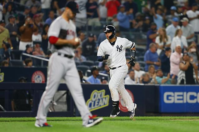 Gary Sanchez rounds third base after hitting a two-run home run to center field during the fifth inning as Rick Porcello of the Boston Red Sox looks. (Getty Images)