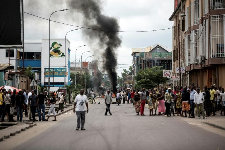 Protesters burn tyres during a demonstration calling for Joseph Kabila to step down