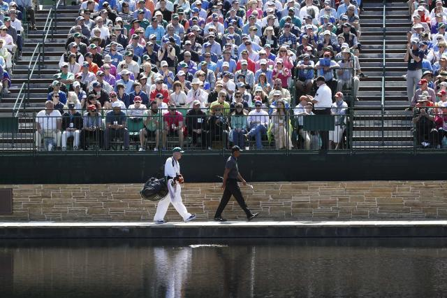 Tiger Woods of the U.S. and his caddie Joe Lacava walk to the 15th green during first round play of the 2018 Masters golf tournament at the Augusta National Golf Club in Augusta, Georgia, U.S., April 5, 2018. REUTERS/Mike Segar