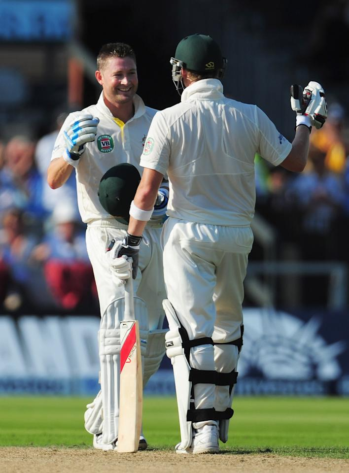 MANCHESTER, ENGLAND - AUGUST 01: Michael Clarke of Australia celebrates his century with Steve Smith during day one of the 3rd Investec Ashes Test match between England and Australia at Old Trafford Cricket Ground on August 1, 2013 in Manchester, England. (Photo by Stu Forster/Getty Images)
