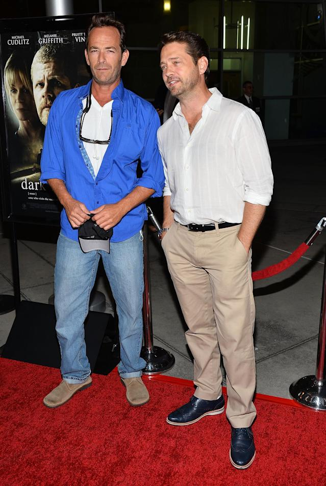 """HOLLYWOOD, CA - AUGUST 14: Actors Luke Perry (L) and Jason Priestley arrive at the premiere of """"Dark Tourist"""" at ArcLight Hollywood on August 14, 2013 in Hollywood, California. (Photo by Amanda Edwards/Getty Images)"""