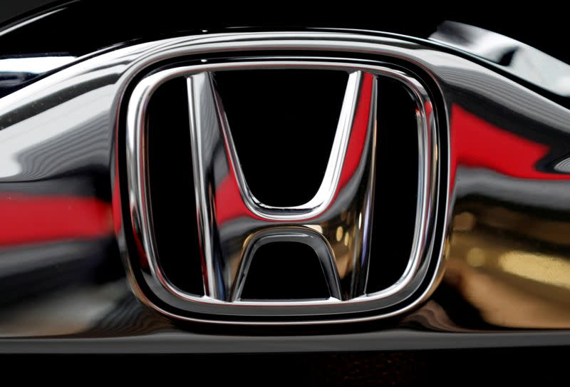 FILE PHOTO: Honda's logo on its Modulo model at its showroom at its headquarters in Tokyo