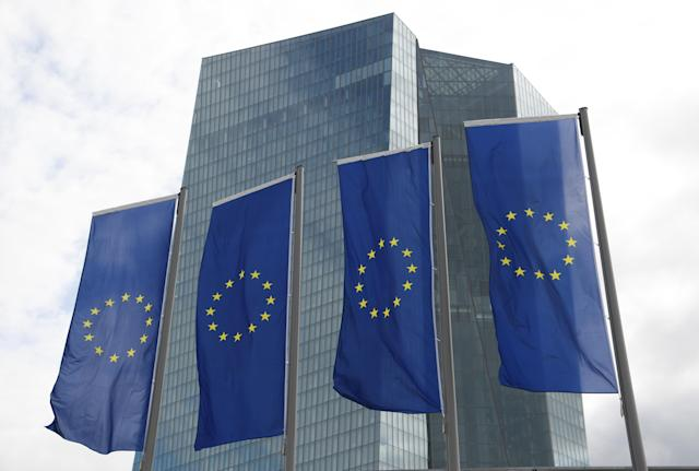 European Union lags fly outside the headquarters of the European Central Bank in Frankfurt. (Arne Dedert/picture alliance via Getty Images)