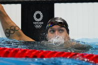 Caeleb Dressel, of United States, finishes a men's 50-meter freestyle semifinal at the 2020 Summer Olympics, Saturday, July 31, 2021, in Tokyo, Japan. (AP Photo/Jae C. Hong)