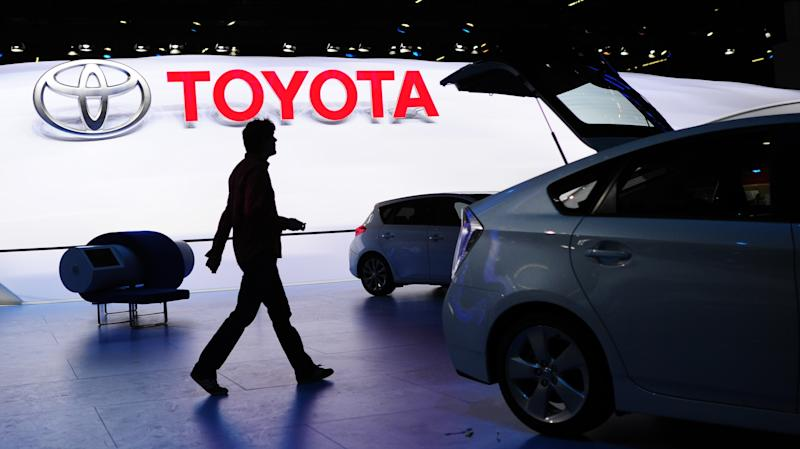 A man walks at the Toyota booth during preparations for the International Motor Show IAA in Frankfurt Germany,Sunday Sept. 8, 2013. The 65th IAA features more than 1,000 exhibitors from around the world and takes place from Sept. 12 to Sept. 22 , 2013. (AP Photo/dpa,Boris Roessler)
