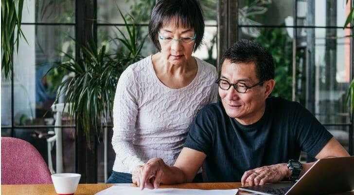 Mature couple reviews their vesting schedule