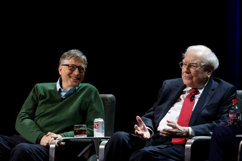 Warren Buffett, chairman and CEO of Berkshire Hathaway, speaks while Bill Gates looks on at Columbia University in New York