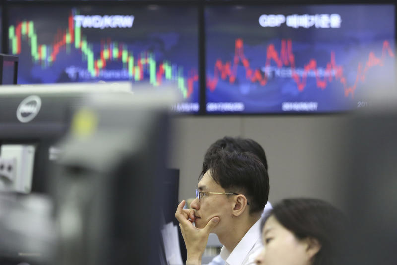 A currency trader watches monitors at the foreign exchange dealing room of the KEB Hana Bank headquarters in Seoul, South Korea, Monday, June 10, 2019. Asian financial markets advanced on Monday after China released better-than-expected trade data for May. Gains were reined in by worries over where the world's two largest economies stood on trade negotiations. (AP Photo/Ahn Young-joon)