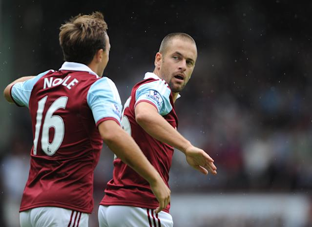 West Ham United's Joe Cole (right) celebrates scoring his side's first goal with team-mate Mark Noble during the Barclays Premier League match at Upton Park, London.