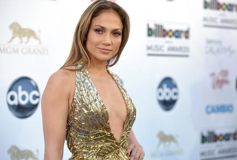 "FILE - In this May 19, 2013 file photo, Jennifer Lopez arrives at the Billboard Music Awards at the MGM Grand Garden Arena in Las Vegas. The ""Happy"" singer Pharrell Williams is set to perform at the first iHeartRadio Music Awards Thursday, May 1, 2014, at the Shrine Auditorium in Los Angeles. Rihanna, Diddy and Lopez will attend, and A-list acts from Drake to Blake Shelton will perform on the show airing live on NBC. (Photo by John Shearer/Invision/AP, file)"