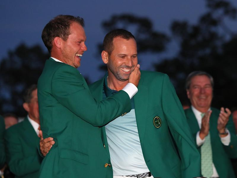 Danny Willett, last year's champion, awards Sergio Garcia with a green jacket: Getty