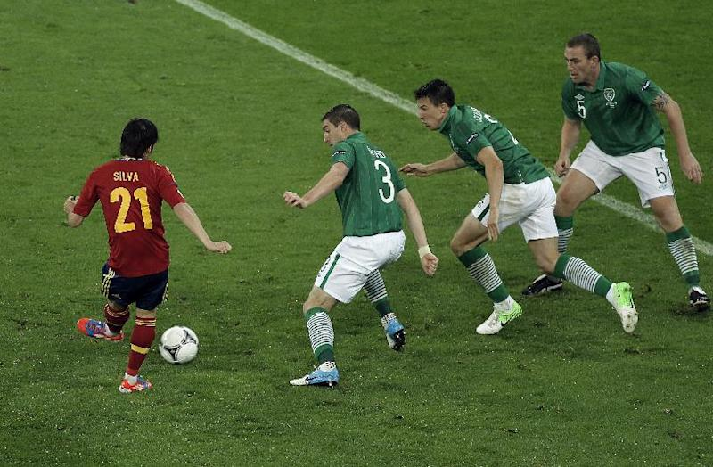 FILE - The June 14, 2012 file photo shos Spain's David Silva scoring his side's second goal during the Euro 2012 soccer championship Group C match between Spain and Ireland in Gdansk, Poland. (AP Photo/Gero Breloer)
