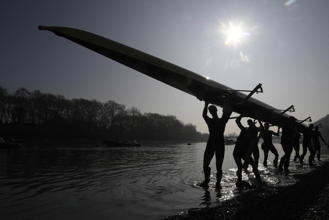 Britain Rowing - Oxford University Boat Race Training - River Thames, London - 28/3/17 The Oxford University men's boat crew carry their boat out of the water following training on the River Thames ahead of this year's Oxford v Cambridge boat race in London Reuters / Toby Melville Livepic