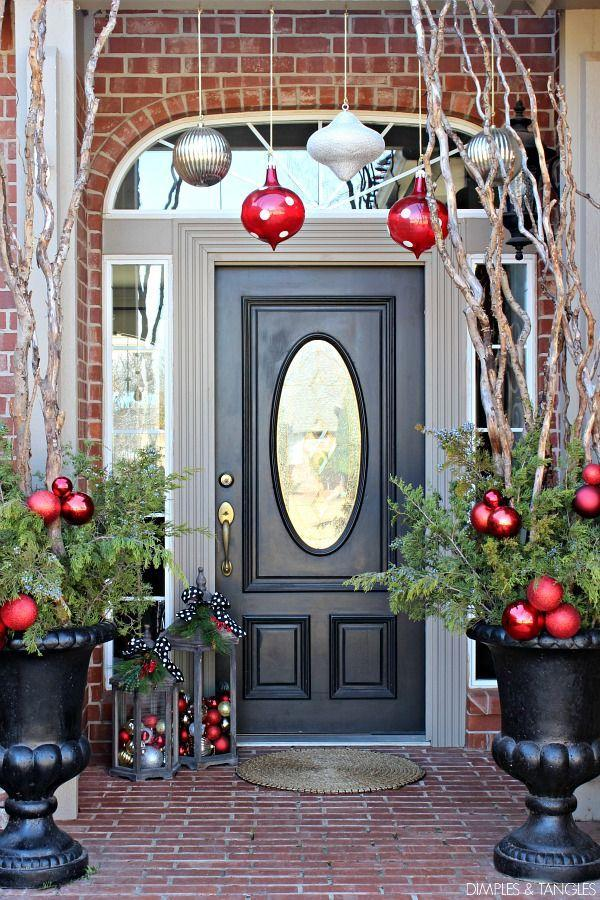 """<p>Ornaments aren't just good for hanging on trees: Oversized ornaments make a stunning impact when hung overhead as part of a pretty porch display.<br></p><p><strong><em>Get the look at <a href=""""https://www.dimplesandtangles.com/2015/12/christmas-tour-part-2-2015-christmas.html"""" rel=""""nofollow noopener"""" target=""""_blank"""" data-ylk=""""slk:Dimples and Tangles"""" class=""""link rapid-noclick-resp"""">Dimples and Tangles</a>.</em></strong> </p>"""