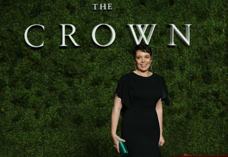 British actress Olivia Colman poses on the red carpet upon arrival for the world premiere of Netflix series 'The Crown - Series 3' in London November 13, 2019. — AFP pic