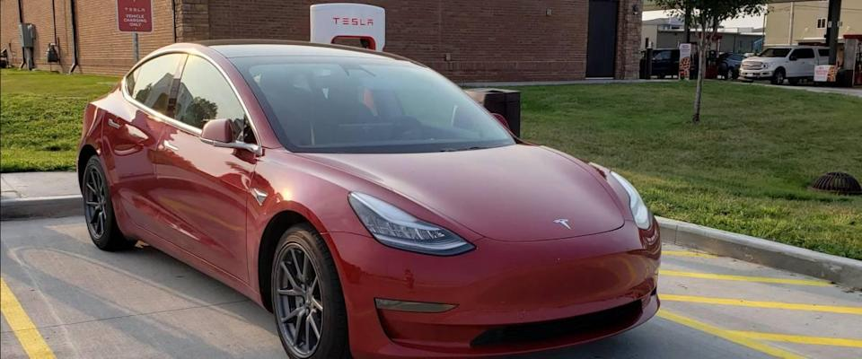 Tesla vehicle in red