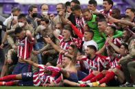 Atletico Madrid players celebrate at the end of the Spanish La Liga soccer match between Atletico Madrid and Valladolid at the Jose Zorrilla stadium in Valladolid, Spain, Saturday, May 22, 2021. Atletico won 2-1 and clinches its 11th Spanish La Liga title. (AP Photo/Manu Fernandez)