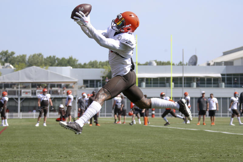 FILE - In this July 29, 2019, file photo, Cleveland Browns wide receiver Odell Beckham Jr. makes a catch during practice at the NFL football team's training facility in Berea, Ohio. Beckham feels reborn with the Browns, who won the mythical offseason championship by landing the three-time Pro Bowler famous for one-handed catches and off-field drama. (AP Photo/Ron Schwane, File)