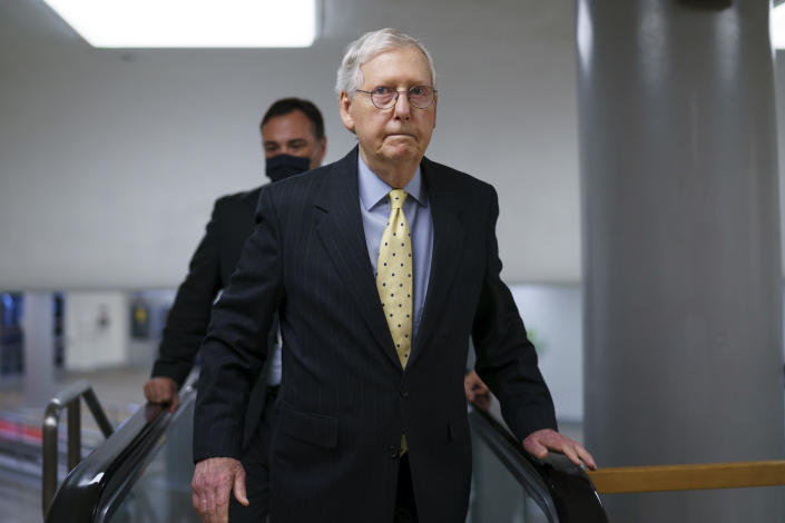 Senate Minority Leader Mitch McConnell, R-Ky., arrives as lawmakers work to advance the $1 trillion bipartisan infrastructure bill, at the Capitol in Washington, Wednesday, Aug. 4, 2021. The 2,700-page bill includes new expenditures on roads, bridges, water pipes broadband and other projects, plus cyber security. (AP Photo/J. Scott Applewhite)