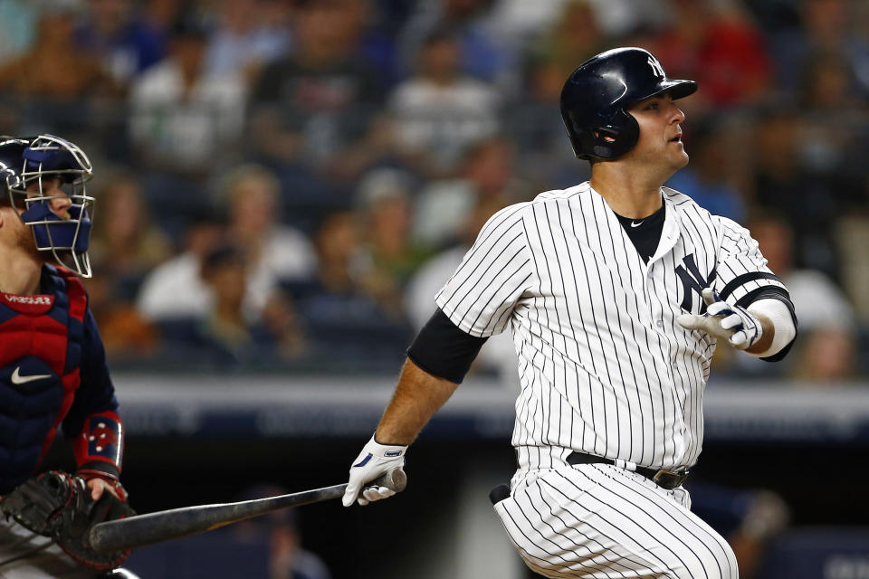 New York Yankees' Mike Ford follows through on an RBI single during the third inning of a baseball game against the Boston Red Sox on Sunday, Aug. 4, 2019, in New York. (AP Photo/Adam Hunger)