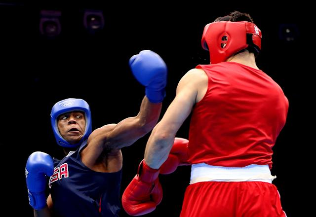 LONDON, ENGLAND - AUGUST 01: Artur Beterbiev of Russia (R) in action with Michael Hunter II of United States during the Men's Heavy (91kg) Boxing on Day 5 of the London 2012 Olympic Games at ExCeL on August 1, 2012 in London, England. (Photo by Scott Heavey/Getty Images)