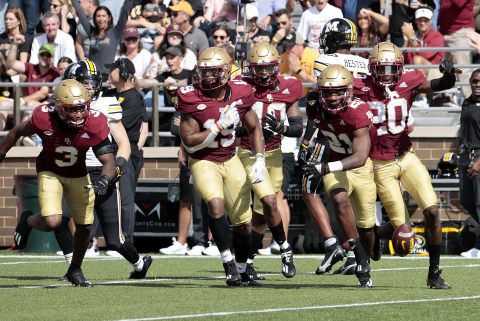 Boston College's Josh DeBerry (21) and teammates celebrate his interception during a game against Missouri on Saturday. (Fred Kfoury III/Icon Sportswire via Getty Images)