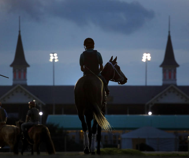 <p>A horse heads onto the track for a morning workout at Churchill Downs Friday, May 4, 2018, in Louisville, Ky. (Photo: Charlie Riedel/AP) </p>
