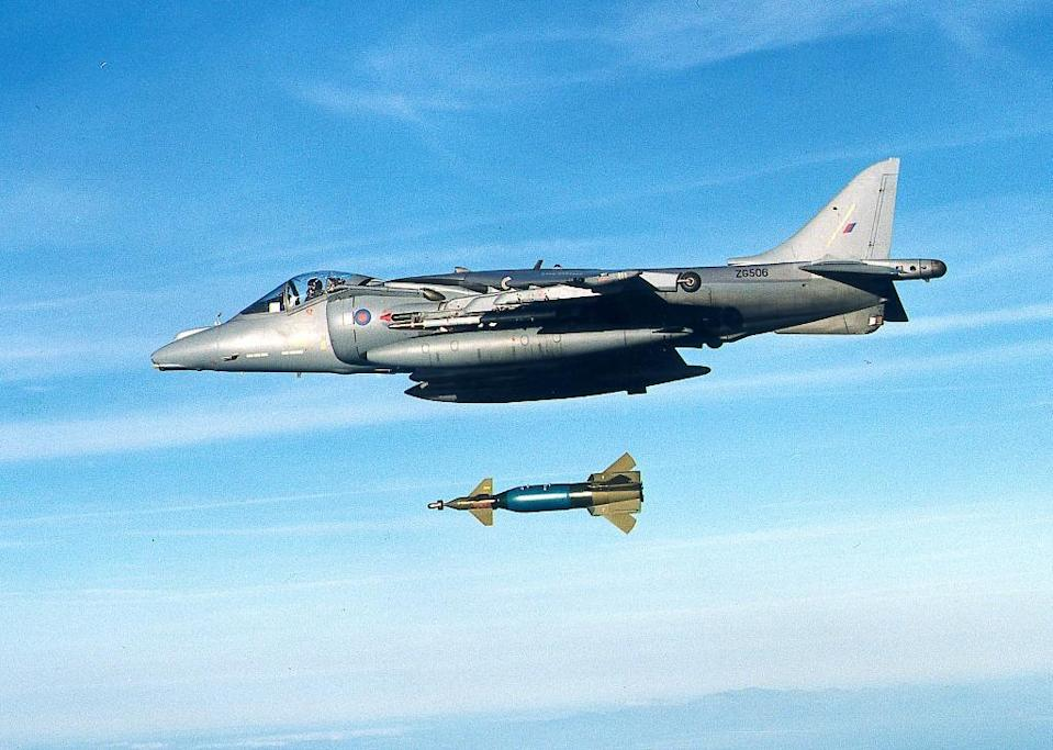 An RAF Harrier drops a Paveway II laser-guided bomb at an undisclosed location (AFP Photo/Jack Pritchard)