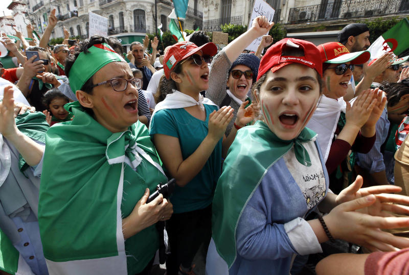 """Algerian protesters gather during an anti-government demonstration in the centre of the capital Algiers, Algeria, Friday, June 7, 2019. Banner in French reads """"Not a monarchy, not a dictatorship. We are one Algeria."""" (AP Photo/Anis Belghoul)"""