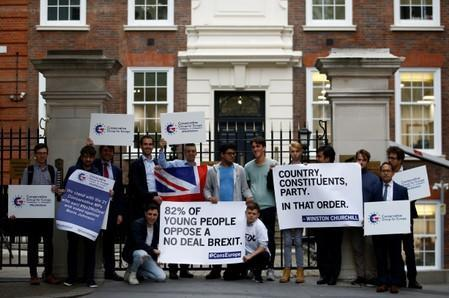 Conservative party members stage a demonstration outside the party's headquarters in London
