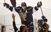 Los Angeles Kings center Anze Kopitar celebrates after a second period goal by Kings' Jeff Carter against the New Jersey Devils during Game 6 of the NHL hockey Stanley Cup finals, Monday, June 11, 2012, in Los Angeles. (AP Photo/Jae C. Hong)