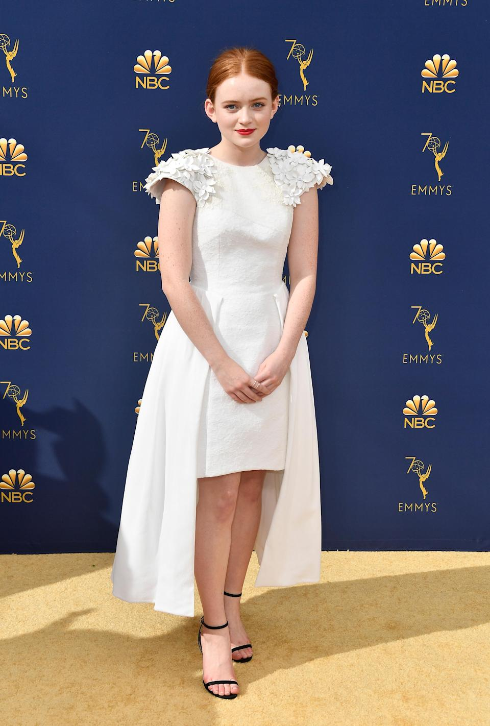 <p>The <em>Stranger Things</em> actress was one of many of her co-stars wearing all white, in a custom Hiraeth dress. (Photo: Getty Images) </p>