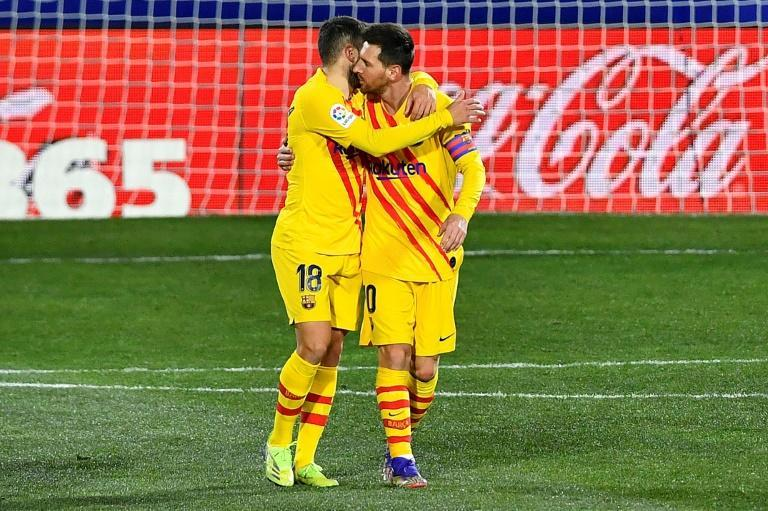 Lionel Messi and Jordi Alba celebrate Barca's opening goal against Huesca
