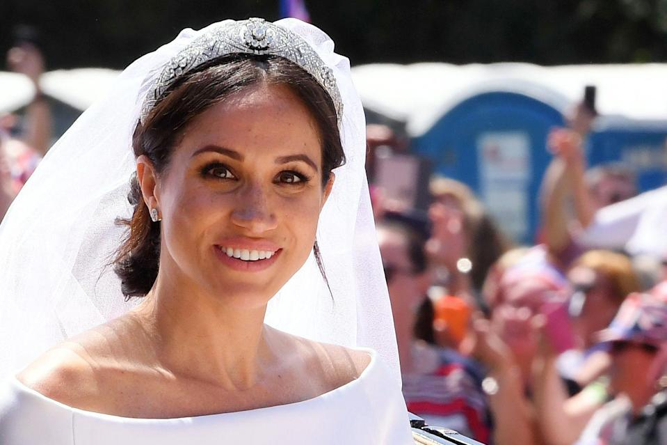 Meghan wearing Queen Mary's diamond bandeau tiara on her wedding day (Rex)
