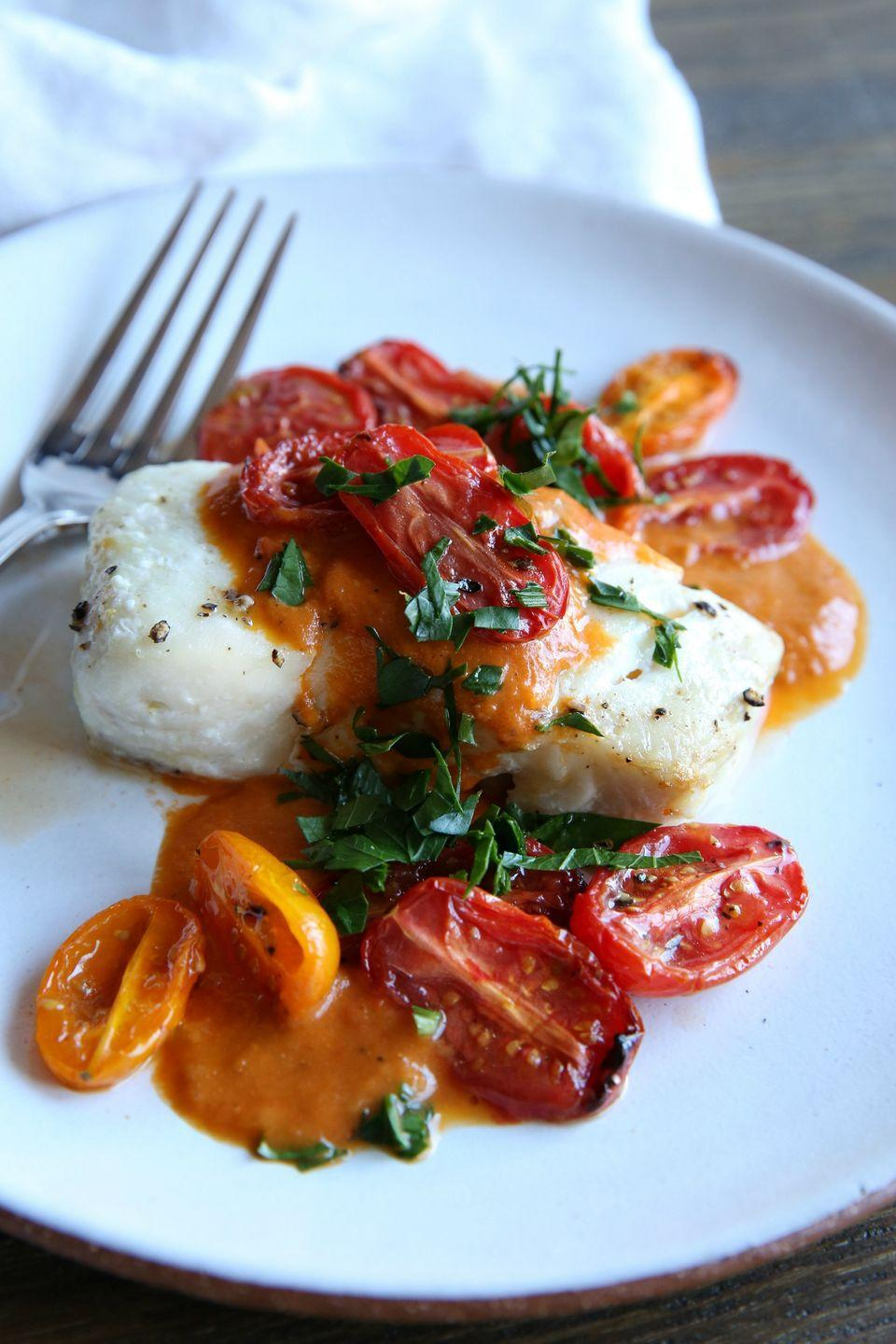 "<p>The perfect light and bright weeknight meal.</p><p>Get the recipe from <a href=""https://www.delish.com/cooking/recipe-ideas/recipes/a46517/roasted-cod-with-tomato-cream-sauce-recipe/"" rel=""nofollow noopener"" target=""_blank"" data-ylk=""slk:Delish"" class=""link rapid-noclick-resp"">Delish</a>.</p>"