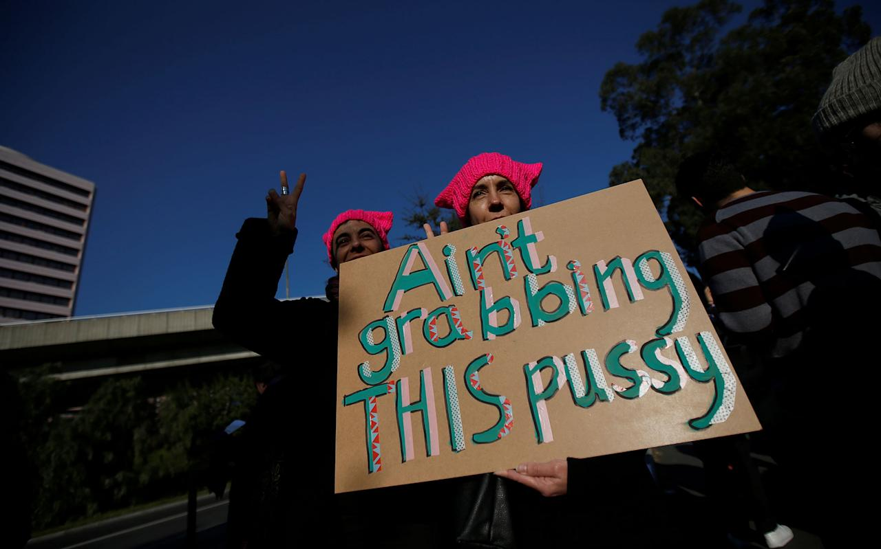 <p>Demonstrators protest against U.S. President Donald Trump next to the U.S. embassy during the Women's March in Lisbon, Portugal January 21, 2017. (Rafael Marchante/Reuters) </p>