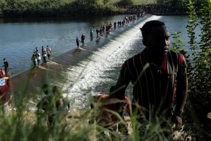 Migrants seeking asylum in the U.S. wait to be processed on the Mexico-U.S. border